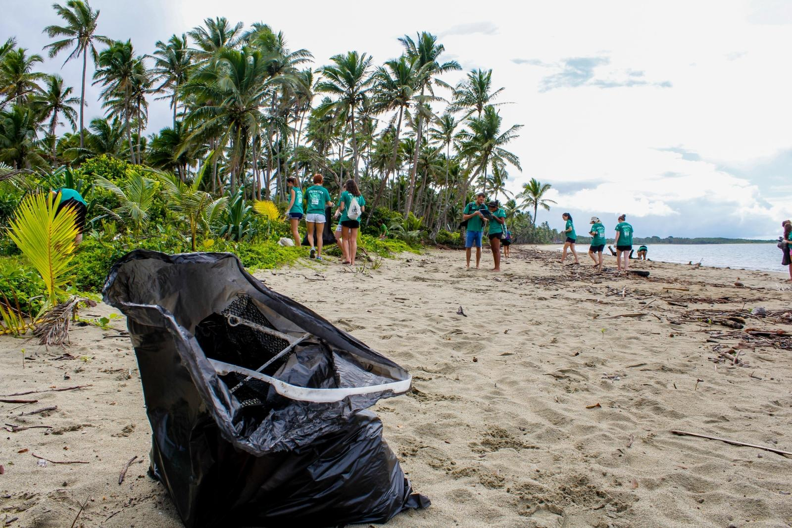 A group of volunteers participating in a beach clean up in Fiji, South Pacific.